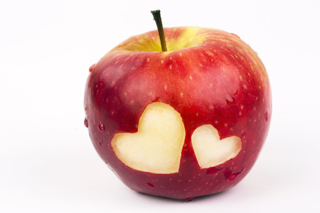 Two hearts on the fresh apple, a Valentines Day theme photo