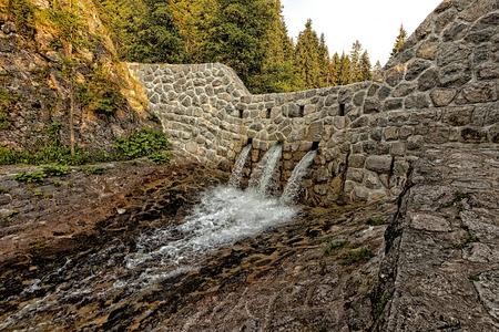 Dam on a stream in Zakopane, in Poland