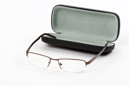 Glasses in a case isolated on white  photo