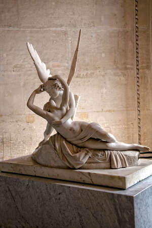 statue: Psyche revived by Cupid s kiss, Louvre, Paris  Editorial