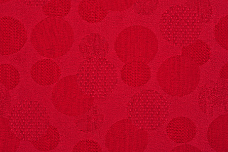 Red material in circles, a background or texture