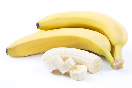 peeled banana: The ripe bananas with pieces Stock Photo