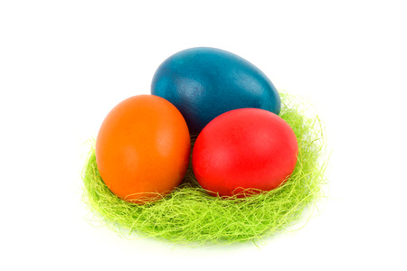 Easter eggs in the nest, on a white background photo