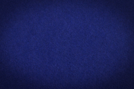 estereotipo: Dark blue paper with vignette and background or texture