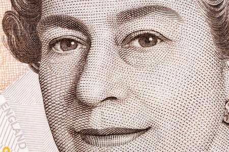 Koningin Elizabeth II de close-up portret op het Britse pond Stockfoto