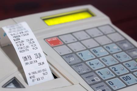 cash receipt: Cash register with cash register receipt Stock Photo