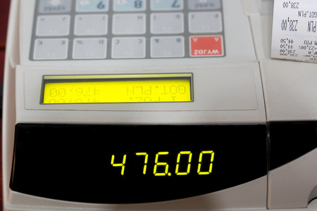 cash slips: Cash register with cash register receipt Stock Photo
