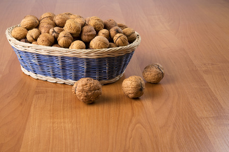 alimentation: Nuts in a basket on a wooden background Stock Photo