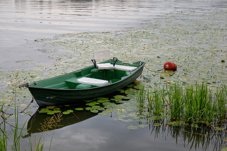 Green boat on the lake
