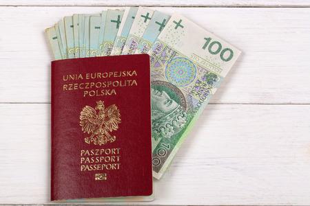 polish: Polish passport with Polish currency