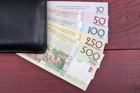 Black wallet with Haitian money