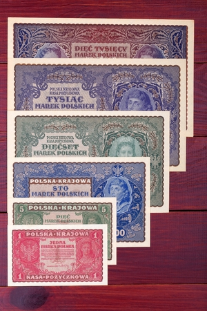 Old Polish money on a wooden background