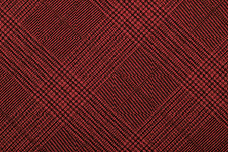 Red material into grid, a background or texture Archivio Fotografico