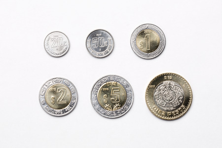 Mexican coins on a white background