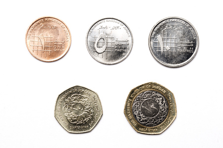 Jordanian coins on a white background Imagens