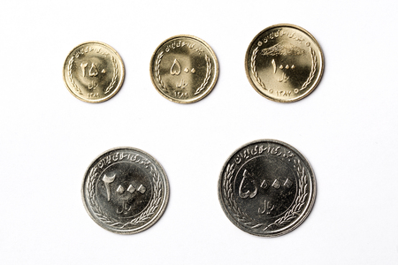 Iranian coins on a white background 版權商用圖片