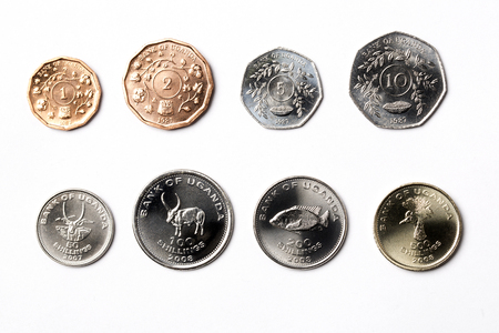 Ugandan coins on a white background
