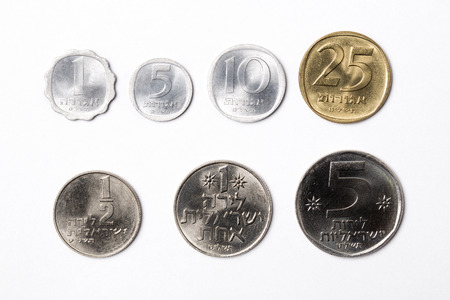 Coins from Israel on a white background Stok Fotoğraf