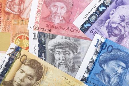 Kyrgyz money as background concept photo