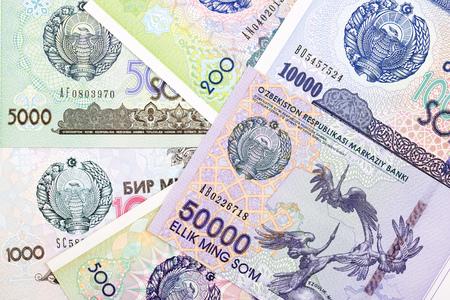 Money from Uzbekistan, a business background Standard-Bild