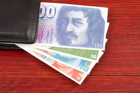 Swiss money in the black wallet