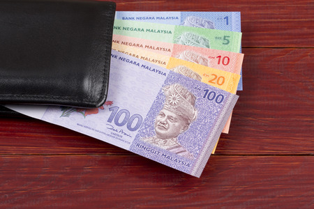 Malaysian money in the black wallet Archivio Fotografico