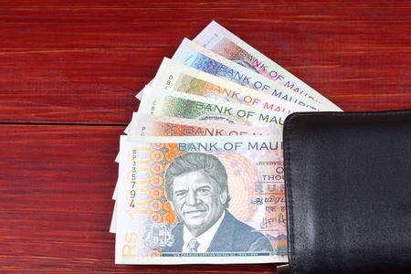 Mauritian money in the black wallet