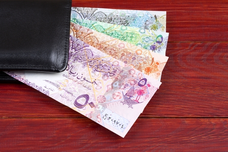 Qatari money in the black wallet Stock Photo - 112530429