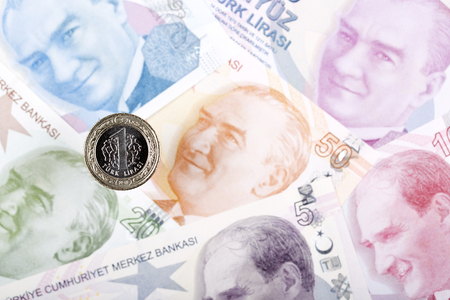 Turkish lira coin on the background of banknotes