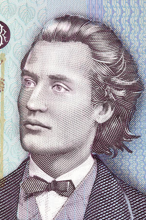 Mihai Eminescu portrait from Romanian money Imagens