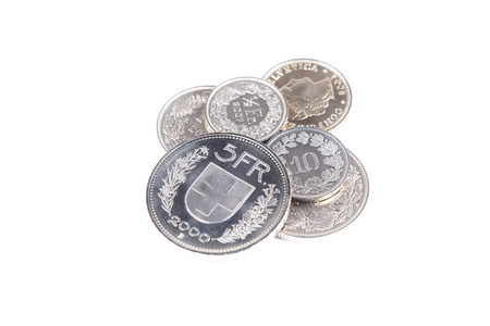Swiss Franc coins on a white background