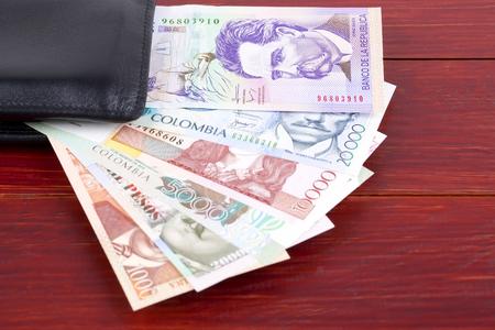 Colombian money in the black wallet