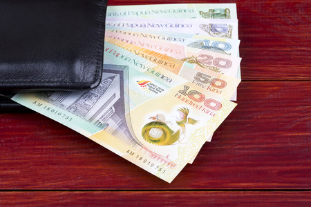 Money from Papua New Guinea in the black wallet Stock Photo