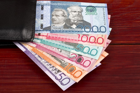 Dominican Pesos in the black wallet Stock Photo