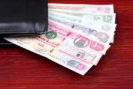 United Arab Emirates Dirham in the black wallet