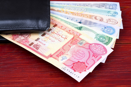 Iraqi Dinar in the black wallet Reklamní fotografie