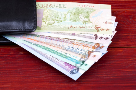 Sudanese Pounds in the black wallet Stock Photo