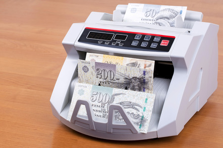 Money from Faroe Islands in a counting machine Stock Photo
