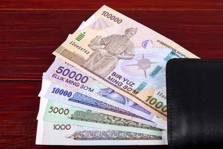 Uzbekistan money in the black wallet
