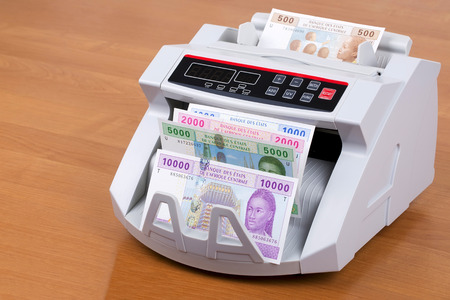 Central African money in a counting machine Stock Photo