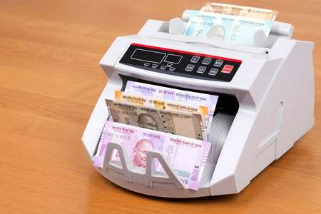 Indian rupee in a counting machine Stock Photo