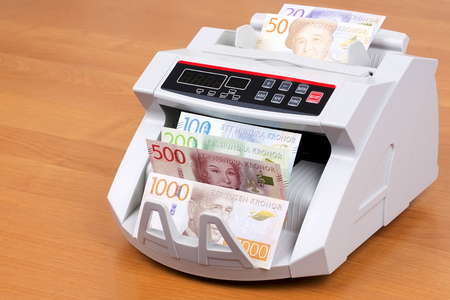 Swedish money in a counting machine