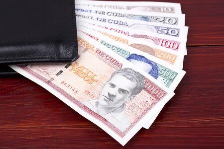 Cuban Pesos in the black wallet