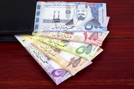 Saudi Riyal in the black wallet