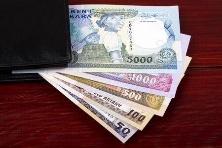 Old money from Madagascar in the black wallet Stock Photo