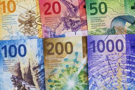 Swiss Francs, a business background with full set of new series Francs