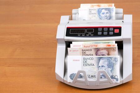 Spanish peseta in a counting machine
