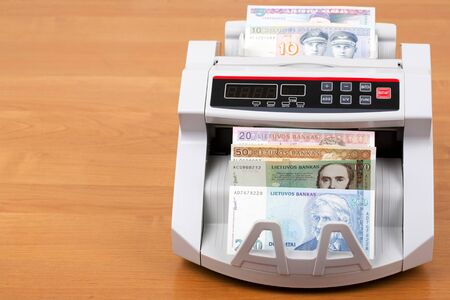 Lithuanian litas in a counting machine