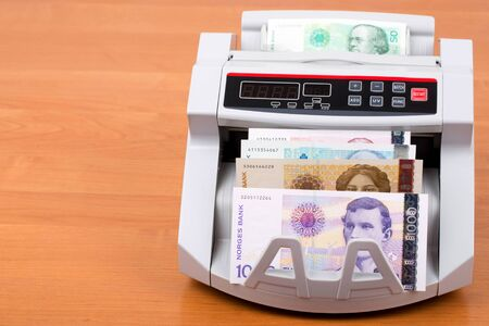 Norwegian krone in a counting machine