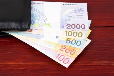 Belgian Franc in the black wallet